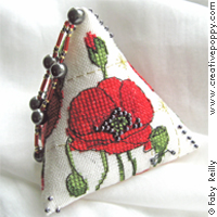 Biscornu au coquelicot, broderie point de croix, cr�ation Faby Reilly