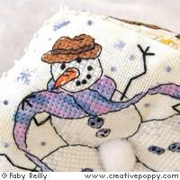 Grilles de broderie point de croix avec des bonhommes de neige