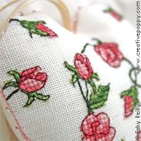 Grilles de point de croix avec des roses