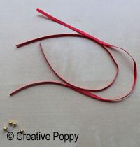 Ruban décoration Noël avec double noeud et embouts perles - étape A