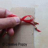 Ruban décoration Noël avec double noeud et embouts perles - étape 3a