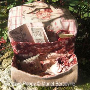 <b>Trousse ronde de la brodeuse</b><br/>grille point de croix<br />création <b>Muriel Berceville</b>